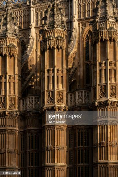 Early morning light on Westminster Abbey with the Winston Churchill Statue in the foreground on the 4th October 2019 in London in the United Kingdom....
