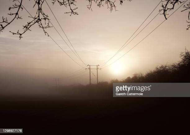 Early morning mist in a field near Stansted Airport on January 27, 2021 in Stansted, United Kingdom.