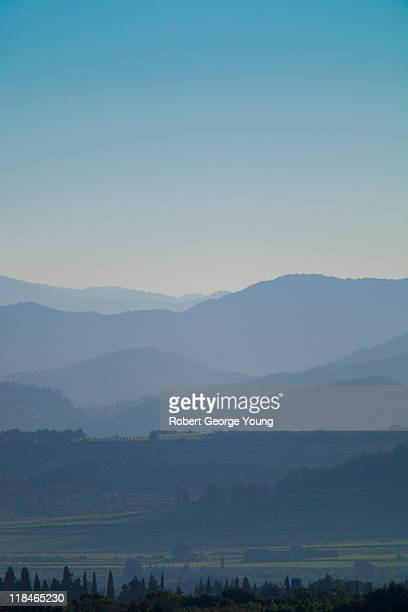 early morning mist, mountains and vineyards - fading stock pictures, royalty-free photos & images