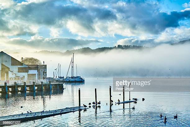 early morning mist on lake windermere - lake windermere stock pictures, royalty-free photos & images