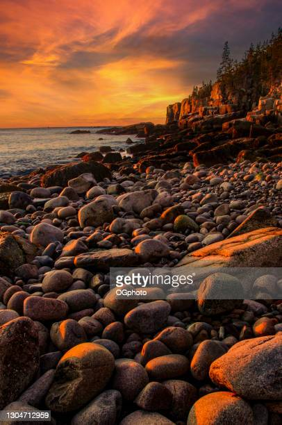 early morning on a stone beach - ogphoto stock pictures, royalty-free photos & images