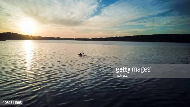 early morning paddling on the lake - southern africa stock pictures, royalty-free photos & images