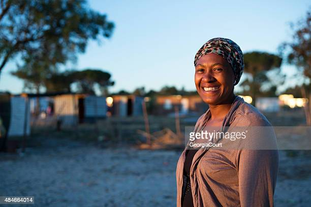 early morning portrait of an african woman smiling - human arm stockfoto's en -beelden
