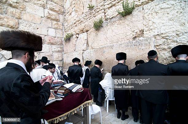 CONTENT] Early morning prayers by the Wailing wall during Passover week Photo taken in the Jewish quarter of the old city of Jerusalem Israel