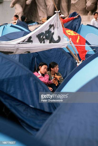 Early morning prodemocracy demonstrators wake up and get out of the tents that they have pitched in Tiananmen Square Prodemocracy demonstrators and...