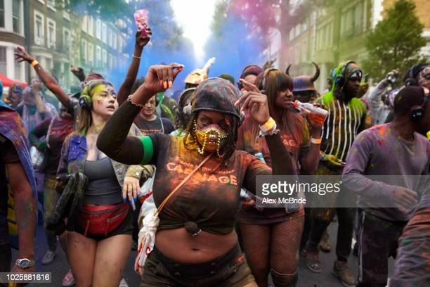 Early morning revellers celebrate Jouvertin Ladbroke Grove on August 26, 2018 as part of Notting Hill Carnival in London, England. The Notting Hill...