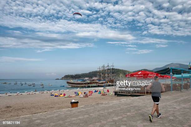 early morning run at ölüdeniz beach in fethiye. - emreturanphoto stock pictures, royalty-free photos & images