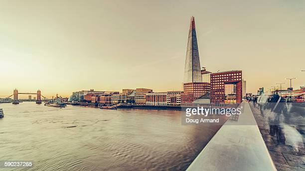 early morning rush hour over london bridge - london bridge stock pictures, royalty-free photos & images