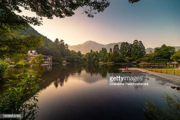 early morning scene of kinrinko (kinrin lake) in yufuin, japan - reflection lake stock photos and pictures