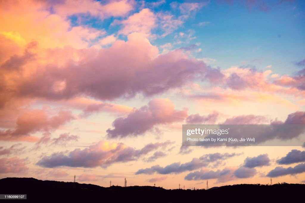 Early morning sky at Okinawa with mountain and electric tower : Stock Photo