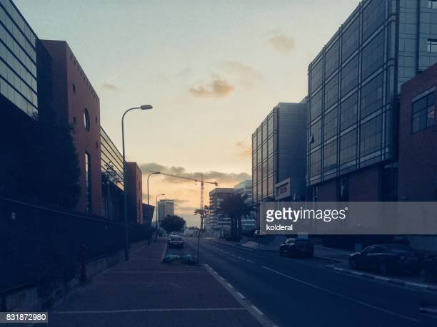 early morning street at industrial district - empty streets stock pictures, royalty-free photos & images