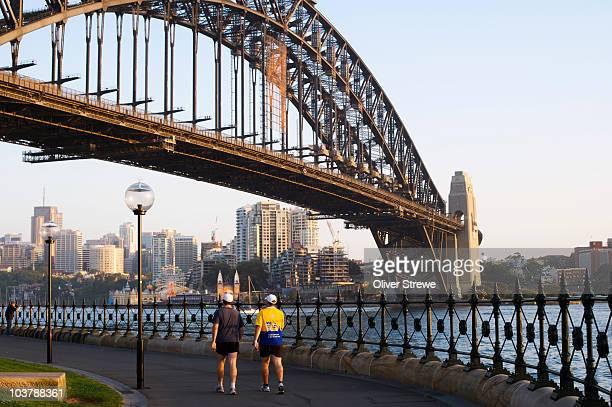 Early morning strolling under Sydney Harbour Bridge.