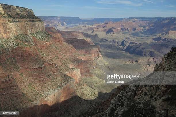 Early morning sun reveals the Grand Canyon as seen from the South Rim on July 13 2014 at Grand Canyon National Park Arizona The Grand Canyon is among...