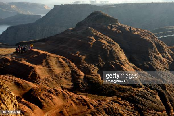 early morning sun shone on the danxia landform - painted hills stock pictures, royalty-free photos & images