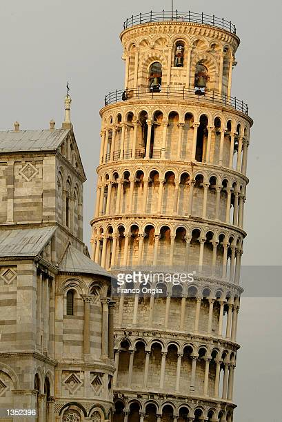 Early morning sunlight shines on the Leaning Tower of Pisa August 24 2002 in Pisa Italy The tower reopened in December 2001 after 10 years of...
