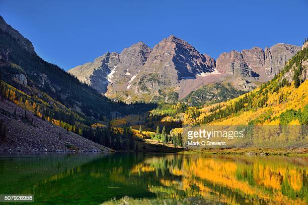 early morning sunshine at maroon bells - white river national forest stock photos and pictures