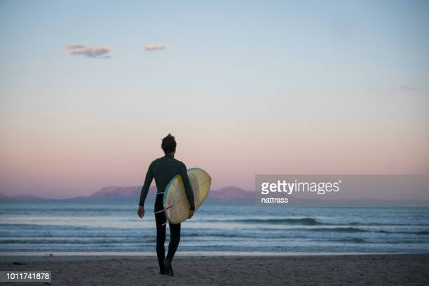 early morning surf - only mid adult men stock pictures, royalty-free photos & images