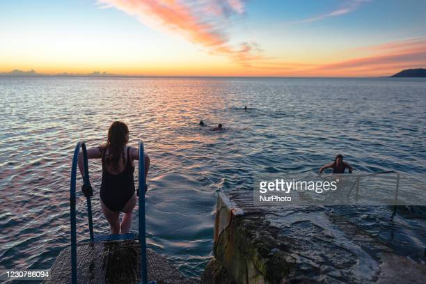 Early morning swimmers at the Vico bathing place, Hawk Cliff, in Dalkey, during Level 5 Covid-19 lockdown. On Monday, 25 January in Dublin, Ireland.