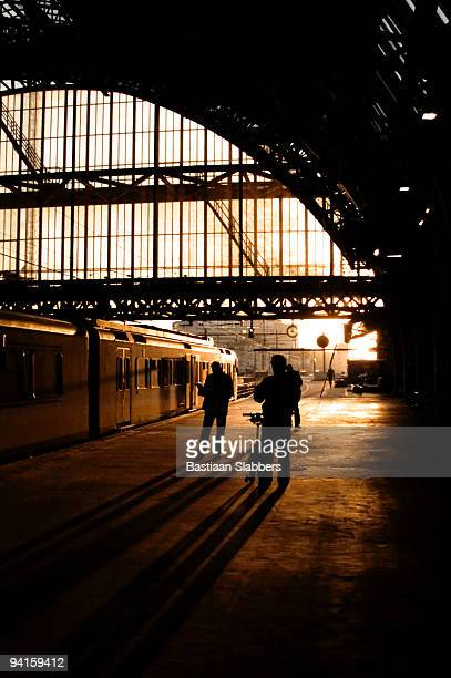 early morning trainstation scene at amsterdam central station - basslabbers, bastiaan slabbers stock pictures, royalty-free photos & images
