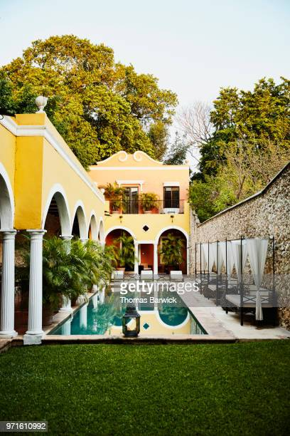 early morning view of boutique hotel courtyard and pool - merida mexico stock photos and pictures