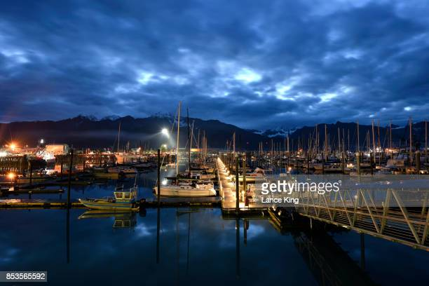 early morning view of seward boat harbor - lance king stock photos and pictures