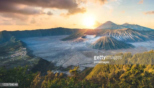 early morning view of the bromo caldeira in east java in indonesia. the volcanic formation of a few volcanoes, with the famous volcano bromo and the semeru volcano in the background - bromo tengger semeru national park stock pictures, royalty-free photos & images