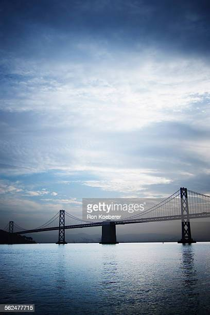 early morning view of the oakland bay bridge. - koeberer stock pictures, royalty-free photos & images