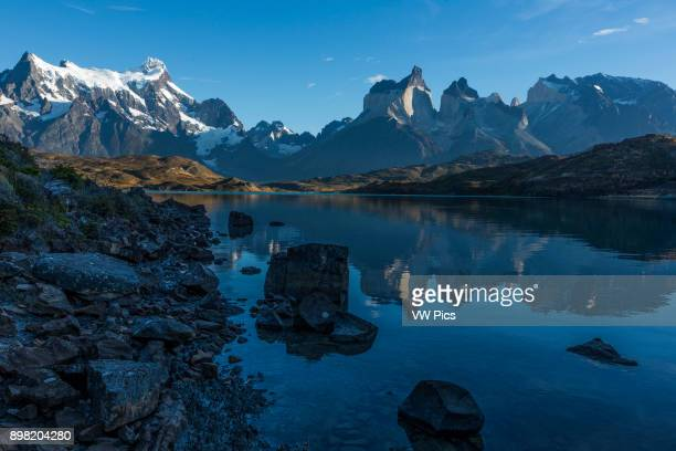 Early morning view of the Paine Massif with reflections Left to right Cerro Paine Grande the Cuernos del Paine or Horns and Monte Almirante NIeto...