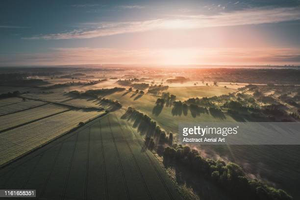 early morning views across the english countryside shot by drone, england, united kingdom - climate change stock pictures, royalty-free photos & images