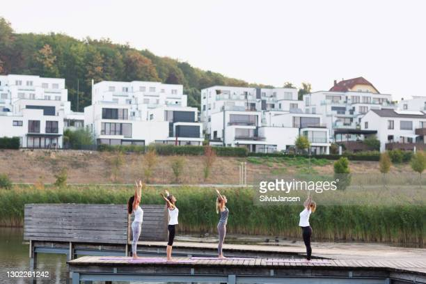 early morning yoga class at lake, but in the city - dortmund city stock pictures, royalty-free photos & images