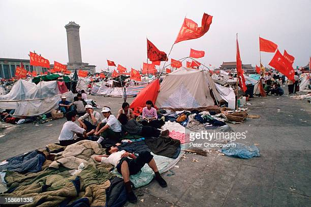 Early one morning, pro-democracy demonstrators wake up after sleeping in the open in Tiananmen Square. Pro-democracy demonstrators and protestors...
