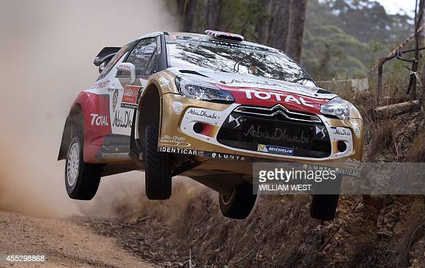 Early pacesetter British rally driver Kris Meeke jumps his Citroen over a brow during the fifth special stage of the World Rally Championship Rally...
