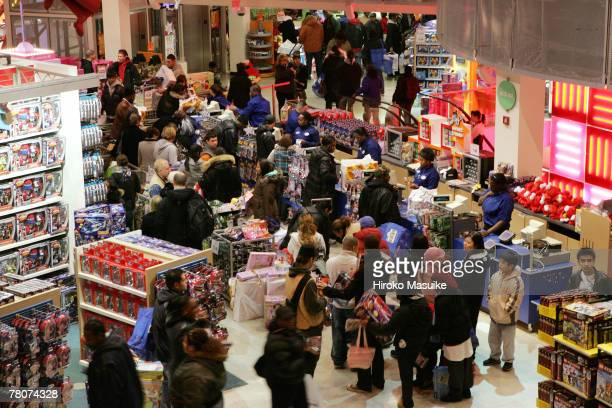 Early shoppers wait online to pay for their goods at the Toys 'R' Us at Times Square November 23 2007 in New York City Black Friday the day after...