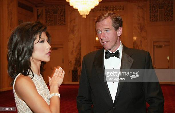 CBS Early Show host Julie Chen and NBC News Anchor Brian Williams attend the International Radio And Television Society Foundation's 2004 Gold Medal...