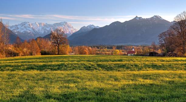 Early spring landscape near the hamlet of Weichs towards the Zugspitze massif, Wetterstein range and Ammergau Alps, Ohlstadt, Loisachtal, The Blue Land, Upper Bavaria, Bavaria, Germany