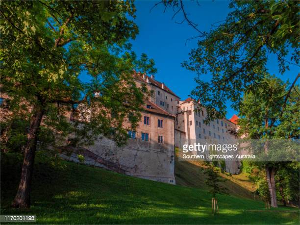 early summer light in the parkland outside the walls of ceski-krumlov castle, czech republic. - cesky krumlov castle stock photos and pictures