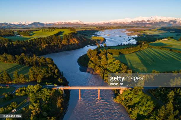 early sunlight over waimakariri river. - canterbury region new zealand stock pictures, royalty-free photos & images