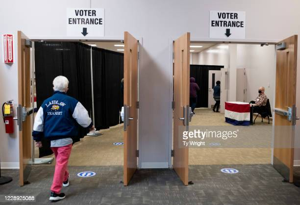Early voters arrive to cast their ballots inside of the Franklin County Board of Elections Office on October 6, 2020 in Columbus, Ohio. Ohio allows...