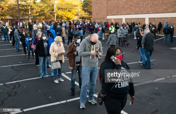 Early voters line up outside of the Franklin County Board of Elections Office on October 6, 2020 in Columbus, Ohio. Ohio allows early voting 28 days...