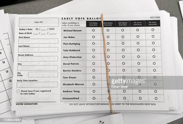 Early voting ballots are stacked on a registration table on the first day of early voting for the upcoming Nevada Democratic presidential caucus at...