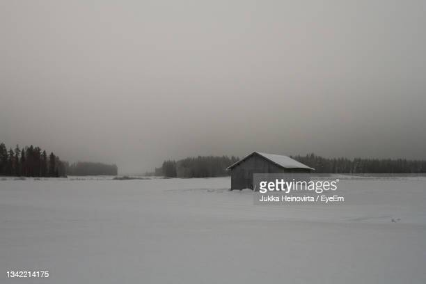 early winter morning on the snowy fields at the northern finland. mist rises over the barn houses. - heinovirta stock pictures, royalty-free photos & images