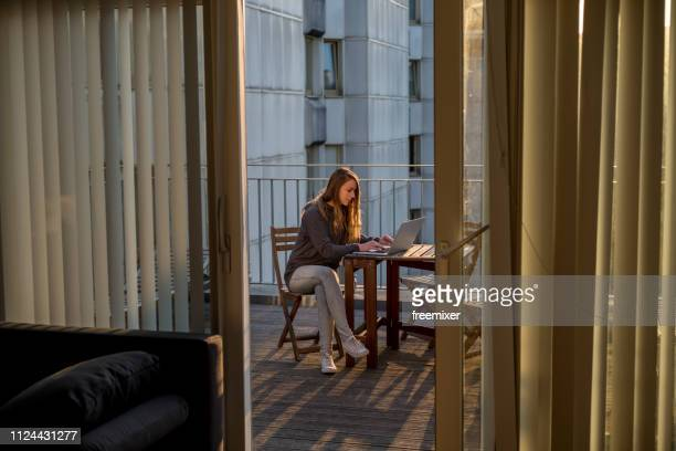 early work - balcony stock pictures, royalty-free photos & images