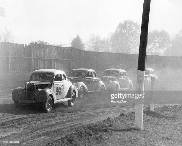 A group of ModifiedSportsman stock cars negotiate a turn at the Greensboro Fairgrounds