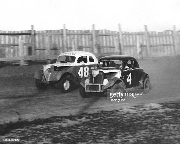 Billy Myers slips to the inside of another competitor to make a pass during a Modified Stock Car race at Greensboro Agricultural Fairgrounds