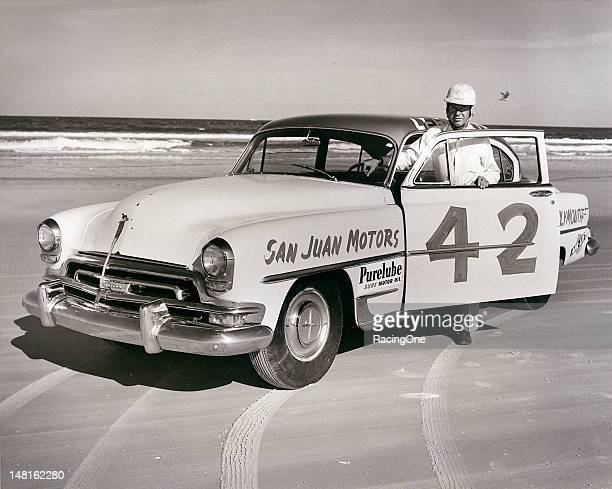 Brewster Shaw owner of San Juan Motors a ChryslerPlymouth dealership in Daytona Beach poses with Lee Petty's NASCAR Cup Plymouth on the Daytona...