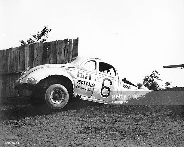 Marshall Teague knocked down a few boards when he crashed his Modified stock car during a race at the Greensboro Fairgrounds