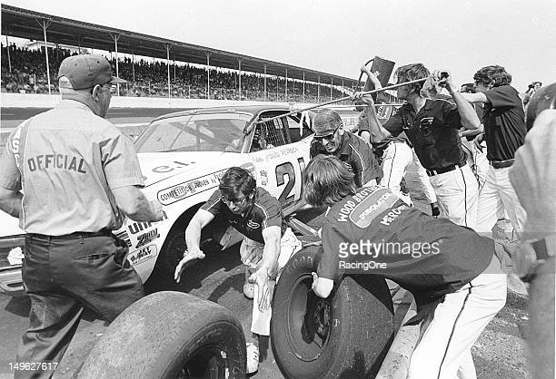 Early-1970s: The Wood Brothers crew goes to work changing left side tires for their driver David Pearson during a NASCAR Cup race at Darlington...