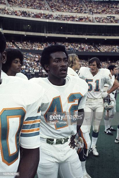 1970s: Wide receiver Paul Warfield of the Miami Dolphins watches the action on the sidelines during a game in the early-1970s against the Cincinnati...