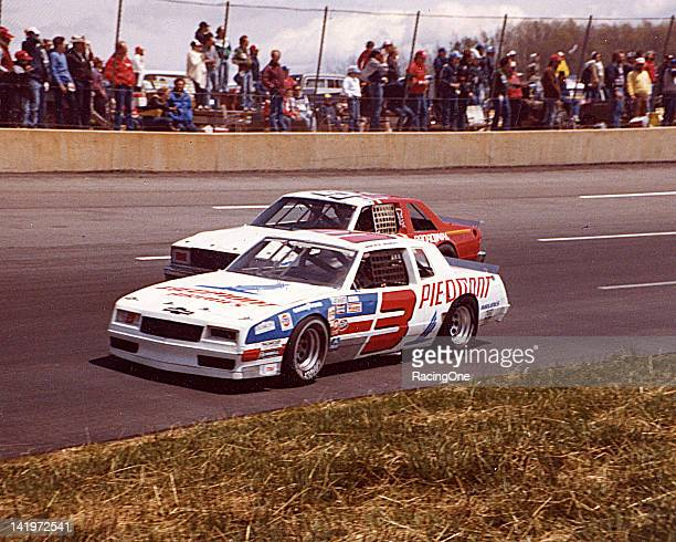 Ricky Rudd passes Jimmy Means during a NASCAR Cup race