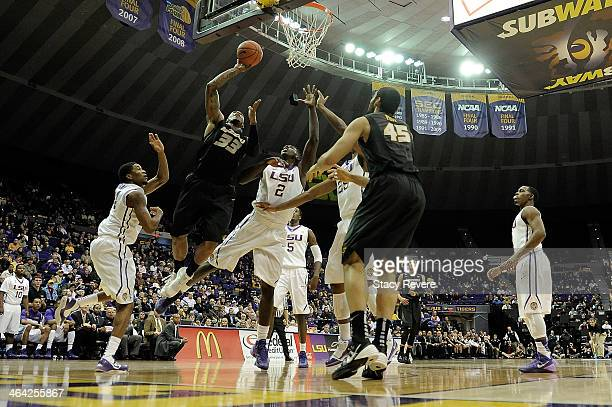 Earnest Ross of the Missouri Tigers shoots in front of Johnny O'Bryant III of the LSU Tigers during a game at the Pete Maravich Assembly Center on...